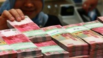 Rupiah Waits for New Booster