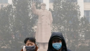 Chinese Cities Issue `Orange` Smog Alert: State Radio