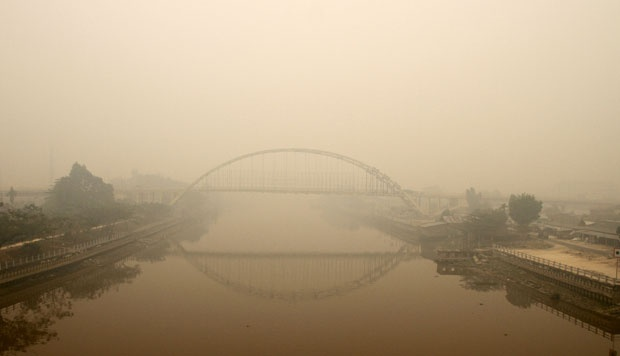 Siak III Bridge in Pekanbaru, Riau is shrouded in haze. ANTARA/Rony Muharrman
