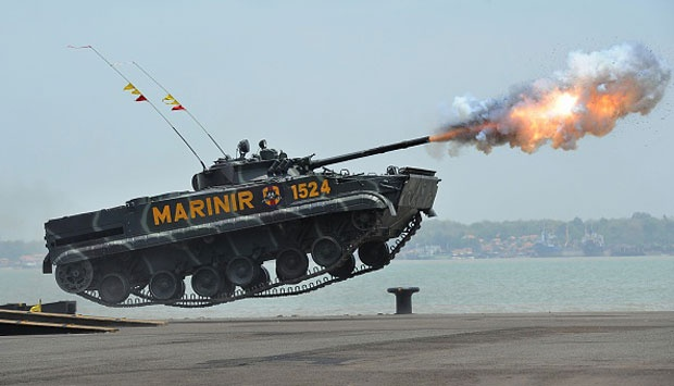 An Indonesian Marine tank jumps and launches missiles during The 69th Republic of Indonesian Military Anniversary in Surabaya (10/7). The 69th Republic of Indonesian Military Anniversary will be the last led by Republic of Indonesia President Susilo Bambang Yudhoyono (SBY). This year's ceremony will be the biggest for the past ten years with the Indonesian Army, Navy, and Air Force all taking part. Robertus Pudyanto/Getty Images