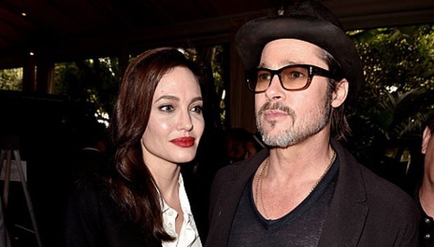 Angelina Jolie (kiri) dan Brad Pitt. Kevin Winter/Getty Images for AFI