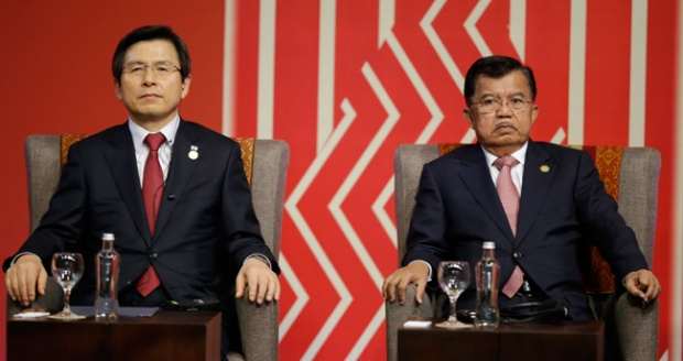 South Korea's Prime Minister Hwang Kyo-ahn, left, and Indonesia's Vice President Jusuf Kalla, attend a meeting with business leaders during the annual Asia Pacific Economic Cooperation, APEC, Summit in Lima, Peru, Nov. 19, 2016. AP/Martin Mejia