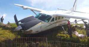 Plane with Broken Wheel Overshoots Runway at Papua Airport