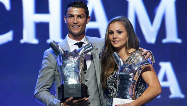 Madrid's forward Cristiano Ronaldo of Portugal, and Lieke Martens of the Netherlands holds their