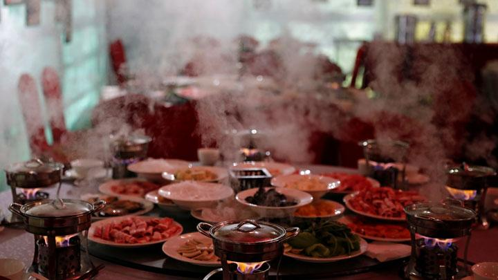 Hot steam rises from hotpots at Shangri-La Hotel's