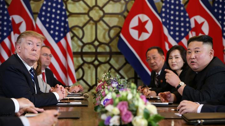 North Korea's leader Kim Jong Un speaks as U.S. President Donald Trump looks on during the extended bilateral meeting in the Metropole hotel during the second North Korea-U.S. summit in Hanoi Vietnam