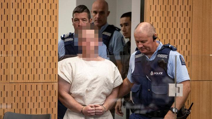 Brenton Tarrant, charged for murder in relation to the mosque attacks, is lead into the dock for his appearance in the Christchurch District Court, New Zealand March 16, 2019. Tarrant has been identified as a suspected white supremacist, based on his social media activity. Mark Mitchell/New Zealand Herald/Pool via REUTERS.