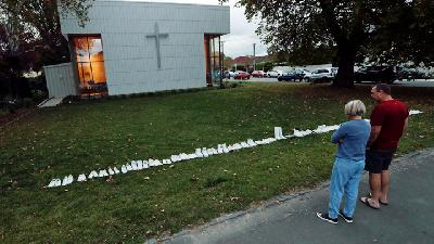 White Shoes Line Church in Memory of New Zealand Victims