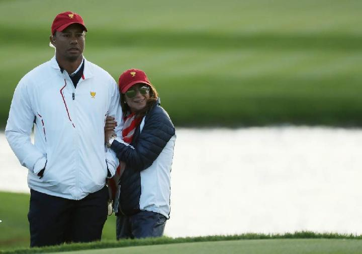 Tiger Woods dan Erica Herman. (heavy.com)