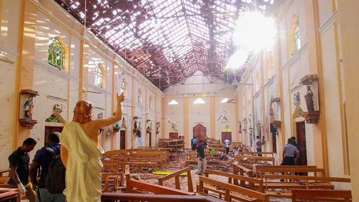 A blood-spattered statue of Jesus Christ is pictured while crime scene officials inspect the site of a bomb blast, as the sun shines through the blown-out roof, inside St Sebastian's Church in Negombo, Sri Lanka April 21, 2019. More than 200 people were killed and at least 450 injured in bomb blasts that ripped through churches and luxury hotels in Sri Lanka on Easter Sunday, the first major attack on the Indian Ocean island since the end of a civil war 10 years ago. REUTERS