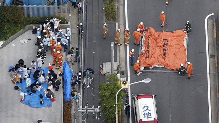 An aerial view shows rescue workers and police officers operate at the site where sixteen people were injured in a suspected stabbing by a man, in Kawasaki, Japan May 28, 2019. One young schoolgirl was killed and at least 12 others were injured in a stabbing at a bus stop just outside the Japanese capital, Tokyo, on Tuesday, national broadcaster NHK cited police as saying. Kyodo/via REUTERS
