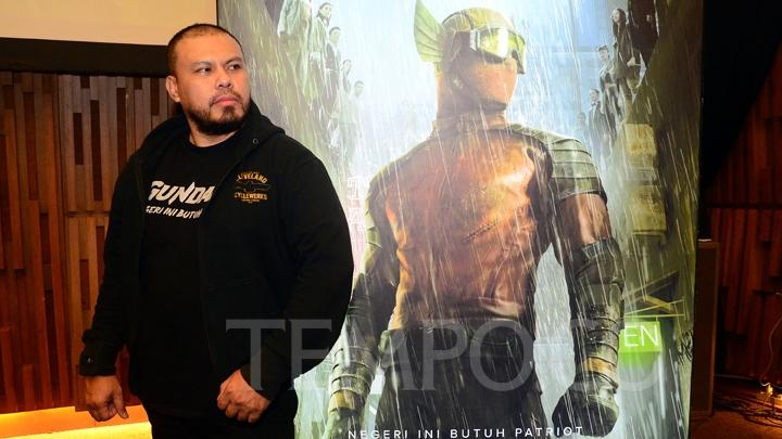 Film director Joko Anwar poses in front of a Gundala poster in Jakarta, May 28, 2019. Gundala is set to premiere at cinemas nationwide on August 29, 2019. TEMPO/Nurdiansah