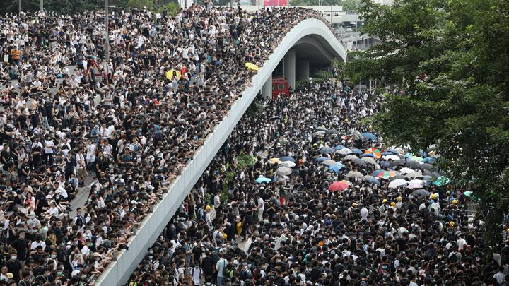 Protesters march along a road demonstrating against a proposed extradition bill in Hong Kong, China June 12, 2019. But many accuse China of extensive meddling since then, including obstruction of democratic reforms, interference with local elections and of being behind the disappearance of five Hong Kong-based booksellers, starting in 2015, who specialised in works critical of Chinese leaders. REUTERS/Athit Perawongmetha