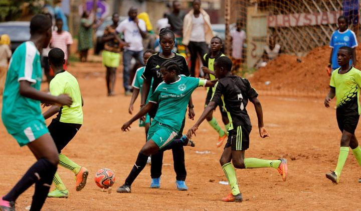 Gaelle Dule Asheri (C), 17, a soccer player, who is amongst the first wave of girls being trained by professional coaches at the Rails Foot Academy (RFA), challenges U15 team players during their friendly match in the RFA field in Yaounde, Cameroon, May 4, 2019. Asheri never gave up her dream despite strong opposition from her mother who feared she would lose her daughter to a