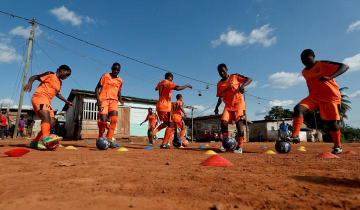 Ida Daniela Pouadjeu (L), 16, a soccer player, attends her training session with her U17 team, who are  amongst the first wave of girls being trained by professional coaches at the Rails Foot Academy at the Rail's field in Yaounde, Cameroon May 2, 2019. Pouadjeu is angry about people's attitude towards female soccer players. An orphan, she was brought up by her aunt who once warned her against playing football saying she would end up sleeping with all the girls at the academy. REUTERS/Zohra Bensemra
