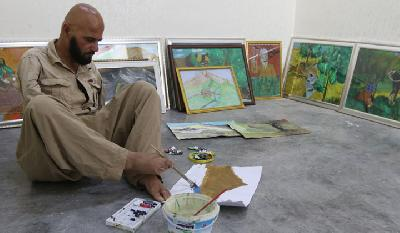 Iraqi Disabled Artist Paints With Feet To Express Anguish