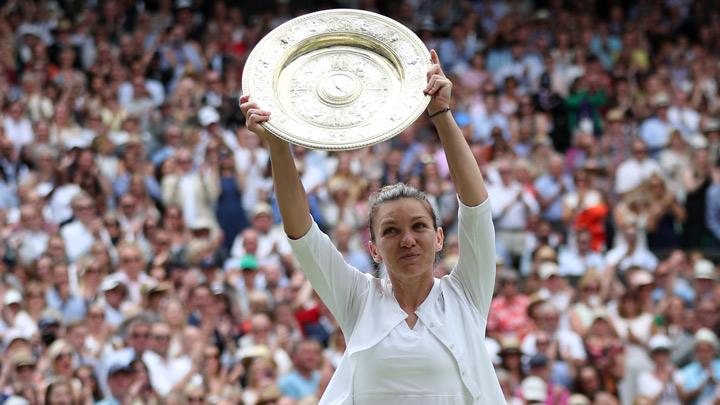 Romania's Simona Halep poses with the trophy as she celebrates after winning the final against Serena Williams of the U.S.  in Wimbledon at All England Lawn Tennis and Croquet Club, London, Britain, July 13, 2019. Simona Halep became the first Romanian to win a Wimbledon singles title after she beat seven-times champion Serena Williams 6-2 6-2 in the final on Saturday. REUTERS/Hannah McKay