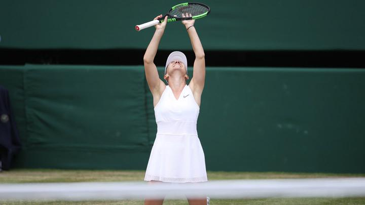 Romania's Simona Halep celebrates winning the final against Serena Williams of the U.S. in Wimbledon at All England Lawn Tennis and Croquet Club, London, Britain, July 13, 2019. Simona Halep became the first Romanian to win a Wimbledon singles title after she beat seven-times champion Serena Williams 6-2 6-2 in the final on Saturday. REUTERS/Carl Recine