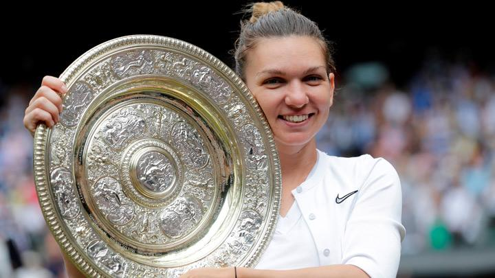 Romania's Simona Halep poses with the trophy as she celebrates after winning the final against Serena Williams of the U.S.  in Wimbledon at All England Lawn Tennis and Croquet Club, London, Britain, July 13, 2019. Simona Halep became the first Romanian to win a Wimbledon singles title after she beat seven-times champion Serena Williams 6-2 6-2 in the final on Saturday. Ben Curtis/Pool via REUTERS
