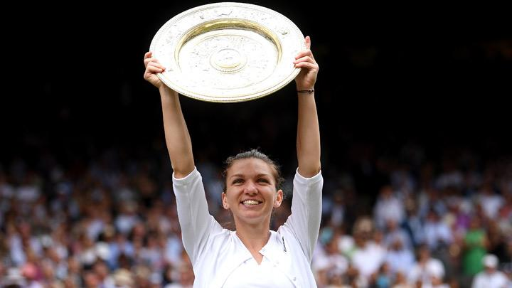 Romania's Simona Halep poses with the trophy as she celebrates after winning the final against Serena Williams of the U.S. in Wimbledon at All England Lawn Tennis and Croquet Club, London, Britain, July 13, 2019. Simona Halep became the first Romanian to win a Wimbledon singles title after she beat seven-times champion Serena Williams 6-2 6-2 in the final on Saturday. Laurence Griffiths/Pool via REUTERS