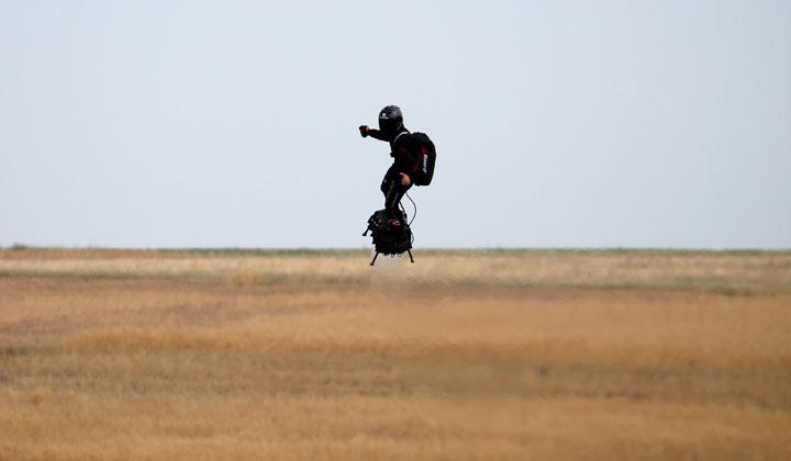 French inventor Franky Zapata flies on a Flyboard during a demonstration as he prepares to cross the English channel from Sangatte in France to Dover, at the Saint-Inglevert aerodrome near Calais, France, July 24, 2019. He will fly at between 15 and 20 metres above the sea as is standard with his invention.  REUTERS/Pascal Rossignol