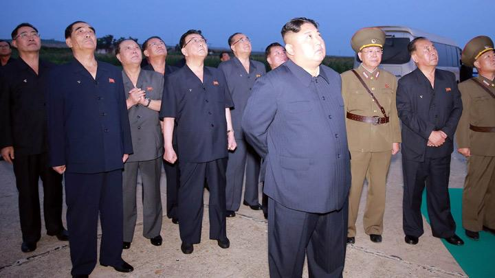 North Korean leader Kim Jong Un watches a missile launch at an unidentified location in North Korea, in this undated image provided by KCNA on August 7, 2019. Tuesday's missile launch, the North's fourth in less than two weeks, came amid stalled denuclearisation talks with Washington and U.S.-South Korea military exercises, although Washington and Seoul played down the tests. KCNA via REUTERS