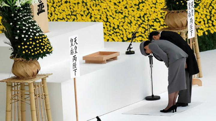 Japan's Emperor Naruhito and Empress Masako bow during a memorial service ceremony marking the 74th anniversary of Japan's surrender in World War Two, in Tokyo, Japan August 15, 2019. Japan's new emperor, Naruhito, expressed deep remorse over the country's wartime past and prayed for global peace on Thursday, echoing his father's words in remarks at an annual ceremony marking Tokyo's surrender in World War Two. REUTERS/Kim Kyung-Hoon
