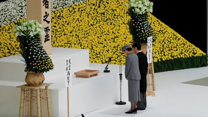 Japan's Emperor Naruhito and Empress Masako pay a silent tribute to the war dead at a memorial service ceremony marking the 74th anniversary of Japan's surrender in World War Two, in Tokyo, Japan August 15, 2019. Naruhito, 59, became Japan's first monarch born after the war when he inherited the throne in May. His father, Akihito, stepped down in the first abdication by a Japanese emperor in two centuries. REUTERS/Kim Kyung-Hoon