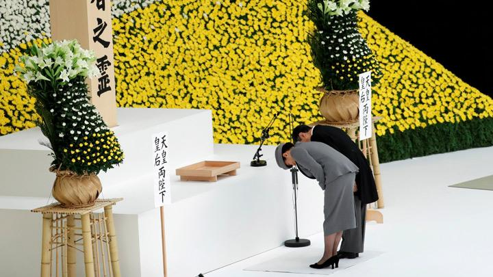 Japan's Emperor Naruhito and Empress Masako bow during a memorial service ceremony marking the 74th anniversary of Japan's surrender in World War Two, in Tokyo, Japan August 15, 2019.