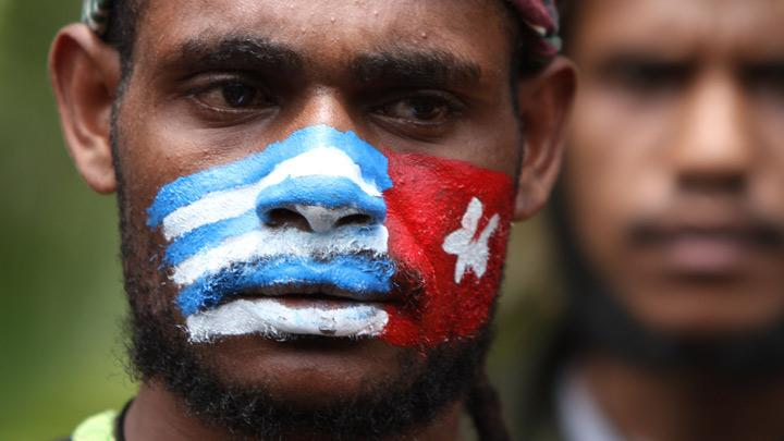 Papuan students staged a protest in front of Indonesia Army headquarters in Jakarta, August 22, 2019. Bearing banners and