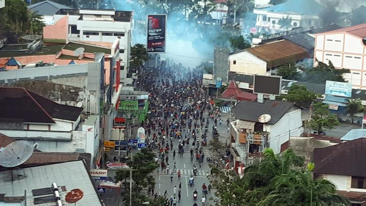 A general view of clashes during a protest in Jayapura, Papua, Indonesia, August 29, 2019. Police fired tear gas to disperse demonstrators who also set fire to cars and threw stones at shops and offices, state news agency Antara said. Protesters also torched a local parliament office.