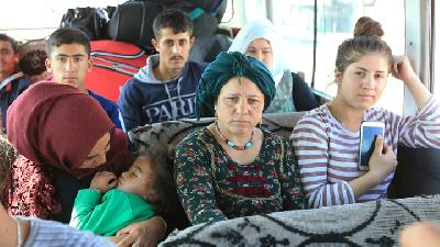 Fleeing Violence, Syrian Kurdish Families Arrive in Iraq