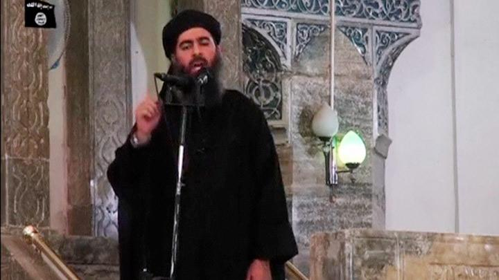 FILE PHOTO: A man purported to be the reclusive leader of the militant Islamic State Abu Bakr al-Baghdadi has made what would be his first public appearance at a mosque in the centre of Iraq's second city, Mosul, according to a video recording posted on the Internet on July 5, 2014, in this still image taken from video. A commander of one of the militant factions in the northwestern Syrian province of Idlib said Baghdadi was believed to have been killed in a raid after midnight on Saturday involving helicopters, warplanes and a ground clash in the village of Brisha near the Turkish border. Social Media Website via Reuters TV/File Photo