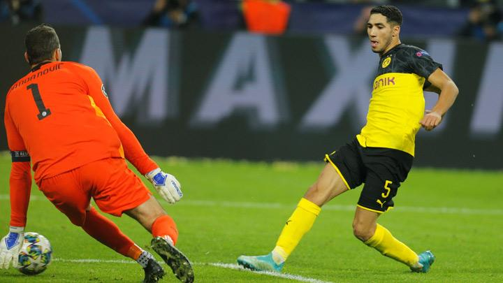 Borussia Dortmund's Achraf Hakimi scores their third goal during the Champions League match, Group F between Borussia Dortmund and Inter Milan at Signal Iduna Park, Dortmund, Germany, November 5, 2019. Hakimi produced a blistering individual performance as he scored twice to help his side overhaul a two-goal deficit and beat Inter Milan 3-2 at home in their Champions League Group F clash on Tuesday. REUTERS/Leon Kuegeler