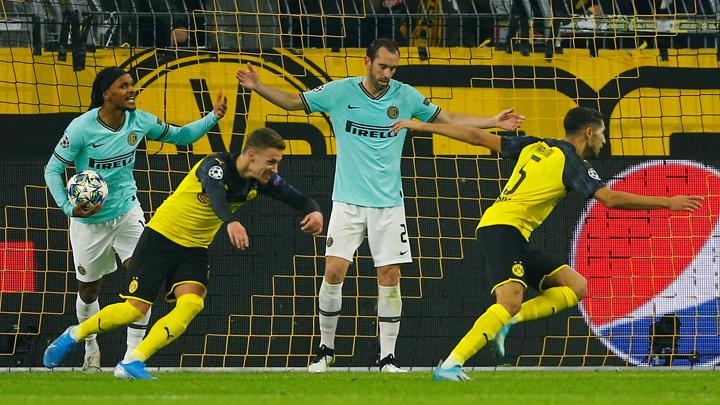 Borussia Dortmund's Achraf Hakimi (R) celebrates scoring their third goal during the Champions League match, Group F between Borussia Dortmund and Inter Milan at Signal Iduna Park, Dortmund, Germany, November 5, 2019. Hakimi produced a blistering individual performance as he scored twice to help his side overhaul a two-goal deficit and beat Inter Milan 3-2 at home in their Champions League Group F clash on Tuesday. REUTERS/Thilo Schmuelgen