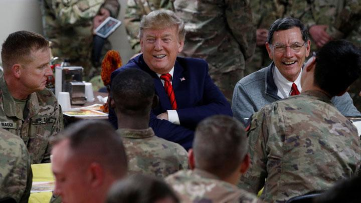 U.S. President Donald Trump eats dinner with U.S. troops at a Thanksgiving dinner event during a surprise visit at Bagram Air Base in Afghanistan, November 28, 2019. Trump his first trip to the country since becoming president and a week after a prisoner swap between Washington and Kabul that raised hopes for a revival of peace talks. REUTERS/Tom Brenner