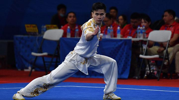 Aksi atlet wushu putra Indonesia Edgar Xavier saat mengikuti final wushu taolu changquan putra SEA Games 2019 di World Trade Center, Manila, Filipina, Ahad, 1 Desember 2019. ANTARA/Sigid Kurniawan