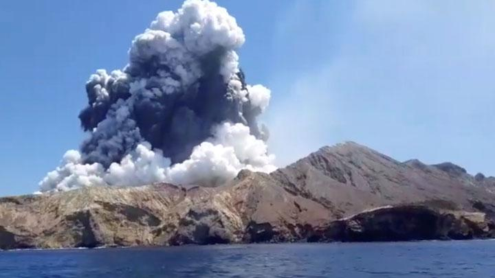 Smoke from the volcanic eruption of Whakaari, also known as White Island, is pictured from a boat, New Zealand December 9, 2019 in this picture grab obtained from a social media video. More than two dozen people were feared missing on Tuesday, a day after a volcano that is a tourist attraction suddenly erupted off the coast of New Zealand's North Island, killing at least five people and injuring up to 20. INSTAGRAM @ALLESSANDROKAUFFMANN/via REUTERS