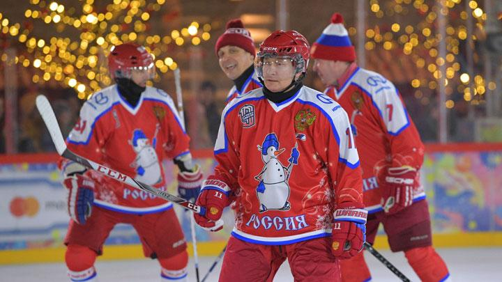 Russian President Vladimir Putin takes part in an exhibition game of the Night Hockey League at an ice rink on Red Square in Moscow, Russia December 25, 2019. The teams are usually composed of the Russian politicians, representatives of the elite and famous Soviet and Russian hockey players. Sputnik/Mikhail Klimentyev/Sputnik via REUTERS