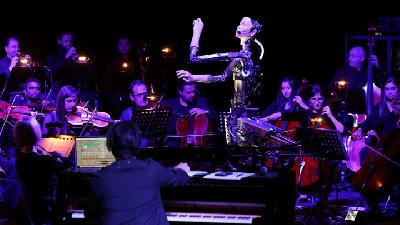 Robot Android Alter 3 Conducts Human Orchestra