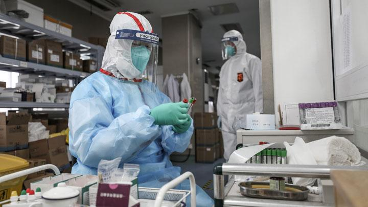 A medical worker in protective suit prepares for an RNA test at Jinyintan hospital in Wuhan, the epicentre of the novel coronavirus outbreak, in Hubei province, China February 13, 2020. China Daily via REUTERS