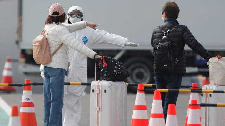 Crew starts disembarking from virus-hit cruise ship for new quarantine