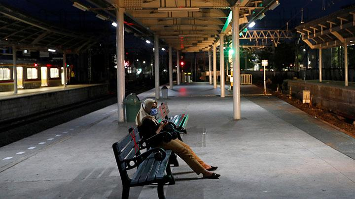 Woman wearing a protective mask sits at an almost empty platform of Jatinegara train station amid the spread of coronavirus disease (COVID-19) outbreak in Jakarta, Indonesia, April 21, 2020. While Jakarta has not imposed a full lock-down, Baswedan said he would increase enforcement of the restrictions in place which include limiting public gatherings. REUTERS/Willy Kurniawan