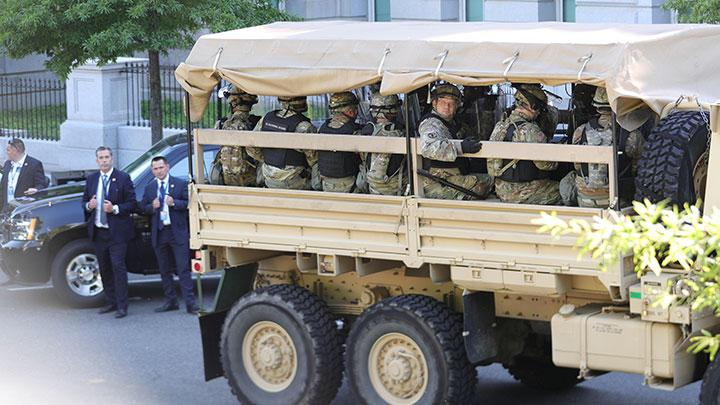 Military vehicles carrying National Guard personnel drive along West Executive Drive, following national protests against the death of George Floyd in Minneapolis police custody, at the White House in Washington, U.S., June 1, 2020. Tensions rose between protesters and military police near White House grounds after U.S. President Donald Trump urged state governors to crack down on protests over racial inequality that have engulfed the nation's major cities, as officials extended curfews in hopes of preventing a seventh night of looting and vandalism. REUTERS/Tom Brenner