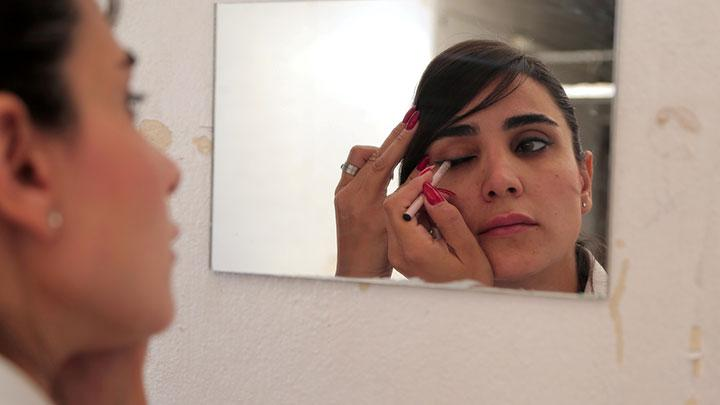 Kinana al-Bunni, 37, a female taxi driver, applies makeup at home before heading to work in Damascus, Syria October 2, 2020. The 37-year-old single mother doesn't only want to provide an income for her two children, but also to change attitudes regarding female drivers. REUTERS/Yamam Al Shaar