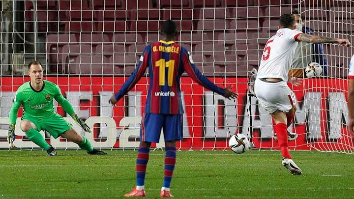 Sevilla's Lucas Ocampos takes a penalty that Barcelona's Marc-Andre ter Stegen saves during the match Copa del Rey Semi Final Second Leg between Barcelona vs Sevilla at Camp Nou, Barcelona, March 3, 2021.  REUTERS/Albert Gea